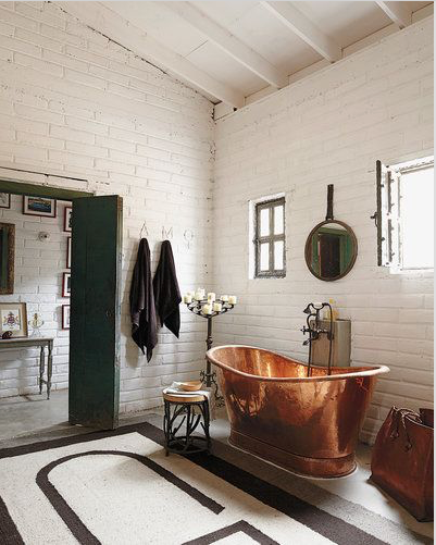 copper tub with black and white